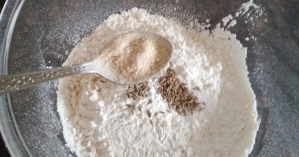 adding cumin and salt to murukku recipe
